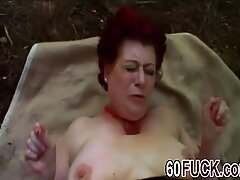 Huge titted granny with moist cunt moans loudly in the forest