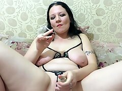 smokes and penetrates herself with a bottle