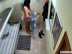 Brunette Teen Girl Tanning her Tight Shaved Pussy